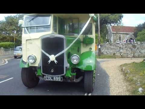 MOV09965 , VINTAGE  BUS  AND  THE  BRIGHSTONE  CHURCH  WEDDING  BELLS .