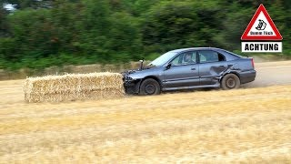 Auto vs. Strohballen - Auspuff selbst gebaut   Dumm Tüch