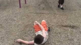 Kid falling off swing on to his face to win jumping contest