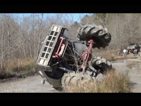 Rolls a GIANT GMC 4×4 Mud Truck