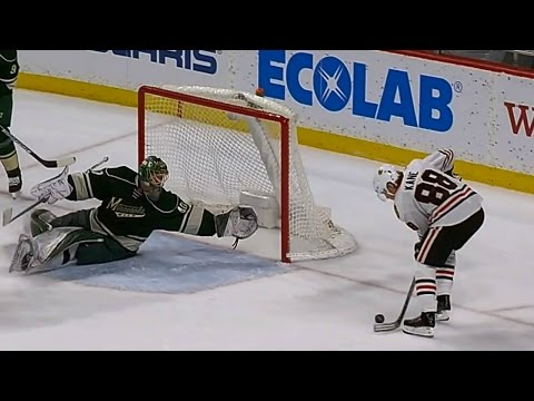 Dubnyk's diving save takes a sure goal away from Kane