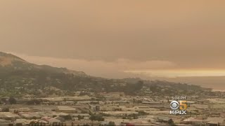 HAZY DAY:  Smoke turns Bay Area skies yellow and filled with ash clouds