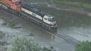 Watch Train Negotiate Flooded Track In NE Colorado