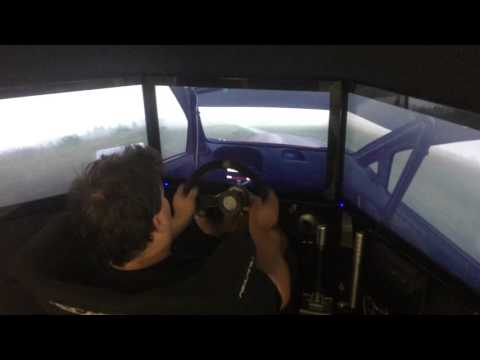 professional rally driver plays a rally driving simulator game