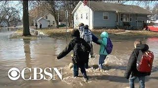 Midwest braces for more rain as deadly and historical flooding devastates the region
