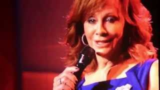 "Reba sings ""The Song Remembers When"""
