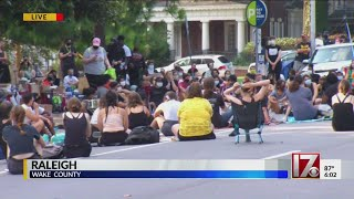Protesters block road at Executive Mansion in Raleigh.