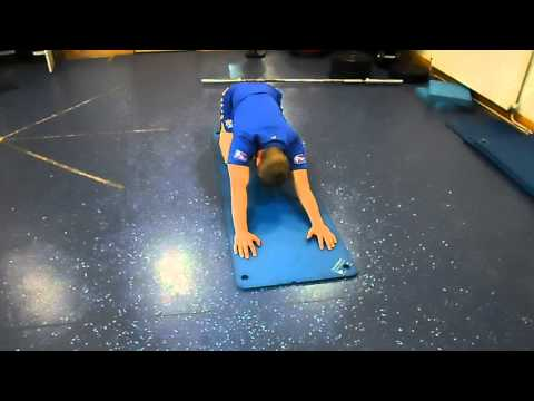 Floor lat stretch with rotation