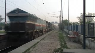 preview picture of video 'Lko Rajdhani Express with an EMD- LKO WDP4B'
