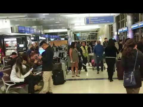 us customs officer tells me to  stop receding in a public airport