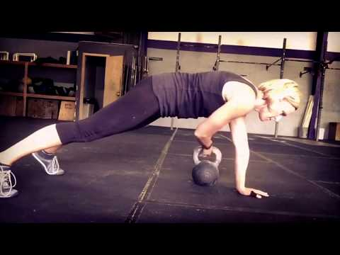 Plank with Kettlebell Drag-Through