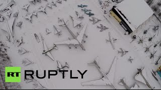 Aerial video: Drone films 100+ Soviet era military planes, helicopters at Moscow region airfield