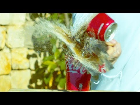 TAGLIARE UNA COCA-COLA IN SLOW MOTION!  (8000 FPS)
