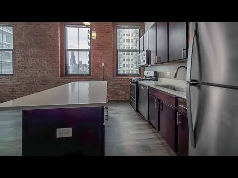 Tour a two-bedroom loft #710 at the South Loop's Carriage House Lofts