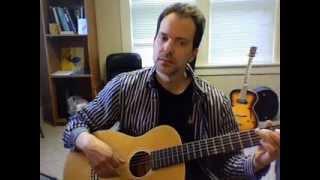 Nylon-string parlor guitar demonstration.