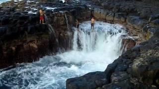 "Queen's Bath - Kauai, HI.  Crazy kids ""Shoot the Ball"""