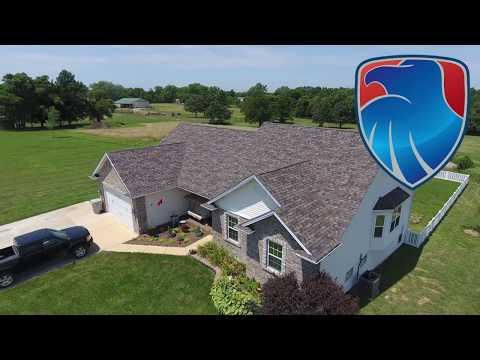 This beautiful home in Wright City MO needed the roof replaced after violent storms damaged the long term protective capability. Once the roof becomes vulnerable it is important to have it replaced like this home owner did. The new Owens Corning Duration Summer Harvest roof looks amazing!