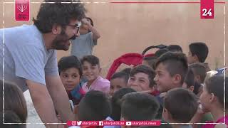 Mobile cinema brings movie magic to Syria Kurd children