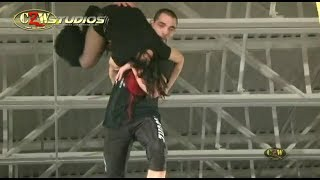 Devon Moore takes Chrissy Rivera for a ride off a scaffold | CZWstudios.com | Cage of Death 14