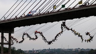 """""""Pure adrenaline"""": 245 rope jumpers take group dive off Brazil bridge"""
