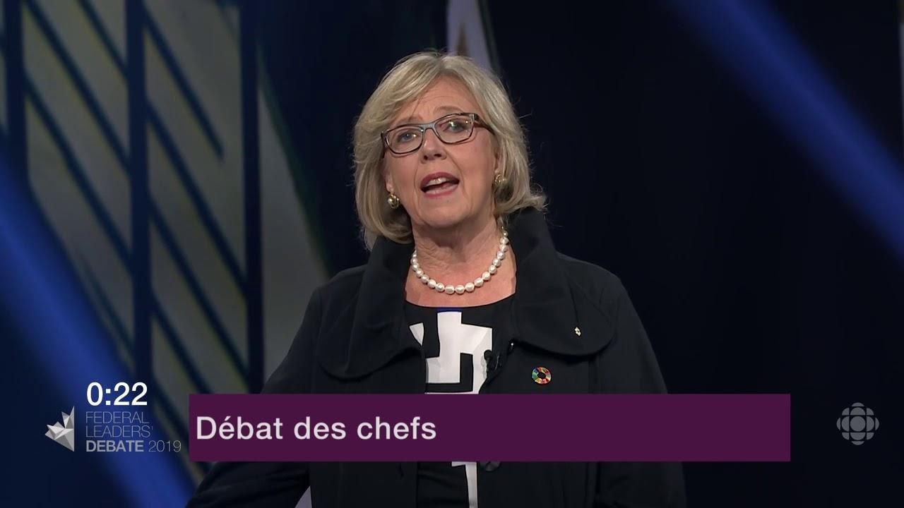 Elizabeth May répond à la question d'un citoyen sur le Canada dans le monde