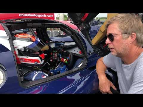 Christian England back in a race car