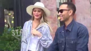 Chrissy Teigen and John Legend go for a stroll with their baby Luna in NYC