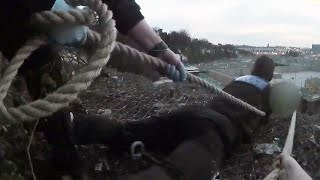 video: Watch: Dramatic rescue as police use belts to save man hanging off a cliff edge