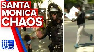 Police disperse looters ransacking LA stores on camera | Nine News Australia