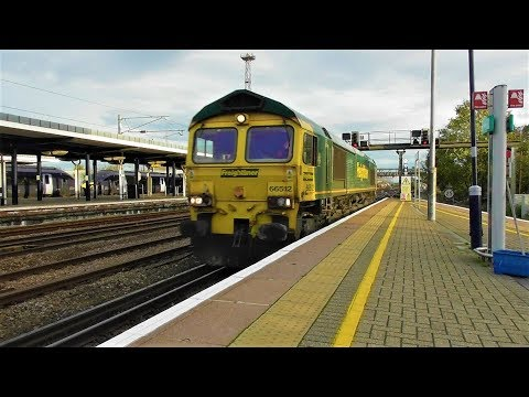 Freightliner 66512 passes Ashford International with ballast…