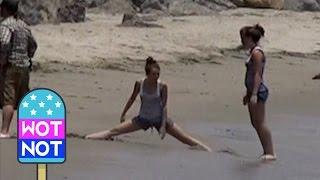 CELEB FLASHBACK: Miley Cyrus Cartwheels & Does The Splits on the Beach