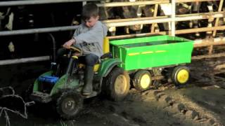 Kids playing on tractors in the mud & john deere gators, children on the farm.