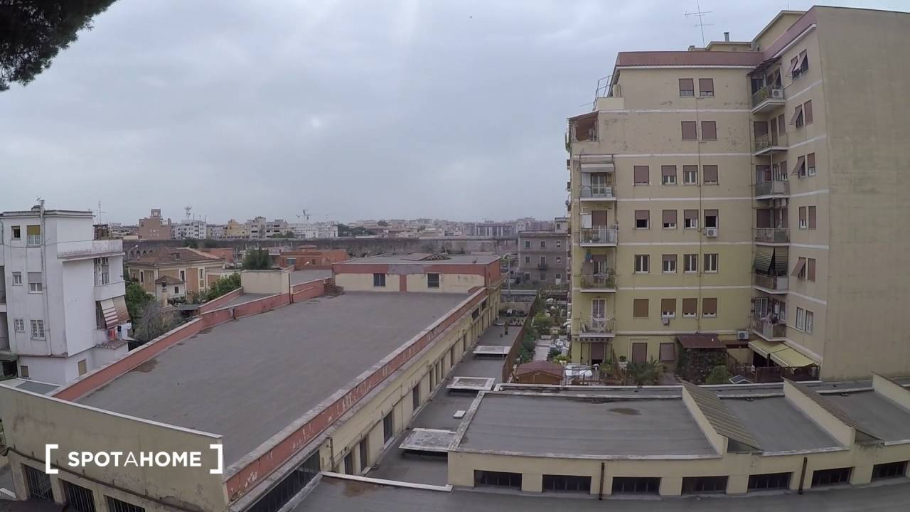 Rooms for rent in 3-bedroom apartment with balcony in Pigneto