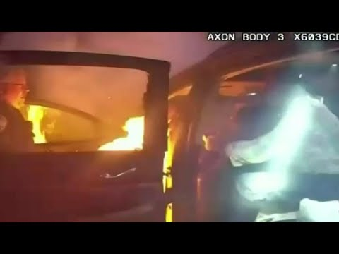 Officers pull woman from burning car in Ohio