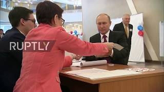 Russia: Vladimir Putin casts his ballot in presidential elections