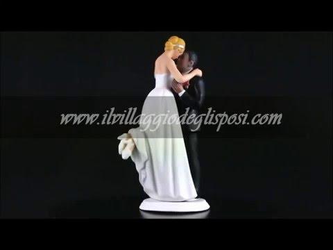 Video - Sposa in braccio allo sposo di colore