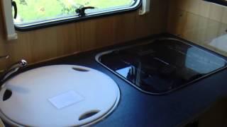 Kampeerauto Te Koop: SUNLIGHT T64   MET HEFBED (VERKOCHT)