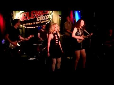 "Kelly performing her original song, ""String,"" with DD White at their premiere show at Arlene's Grocery in NYC (April 2016)"