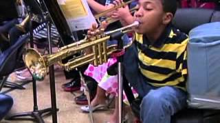 Armless Child Plays Trumpet