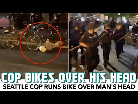 Seattle Cop Runs His Bike Over Injured Man's Head