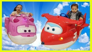 Gambar cover Riding a Super Wings Funny Kids Amusement Super Jet and Dizzy