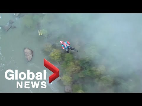 Daredevils BASE jump into New River Gorge at West Virginia Bridge Festival