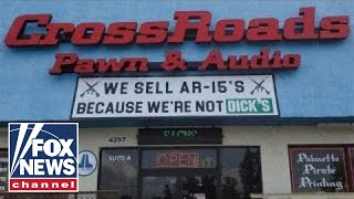 Pawn shop trolls Dick's Sporting Goods with AR-15 sign