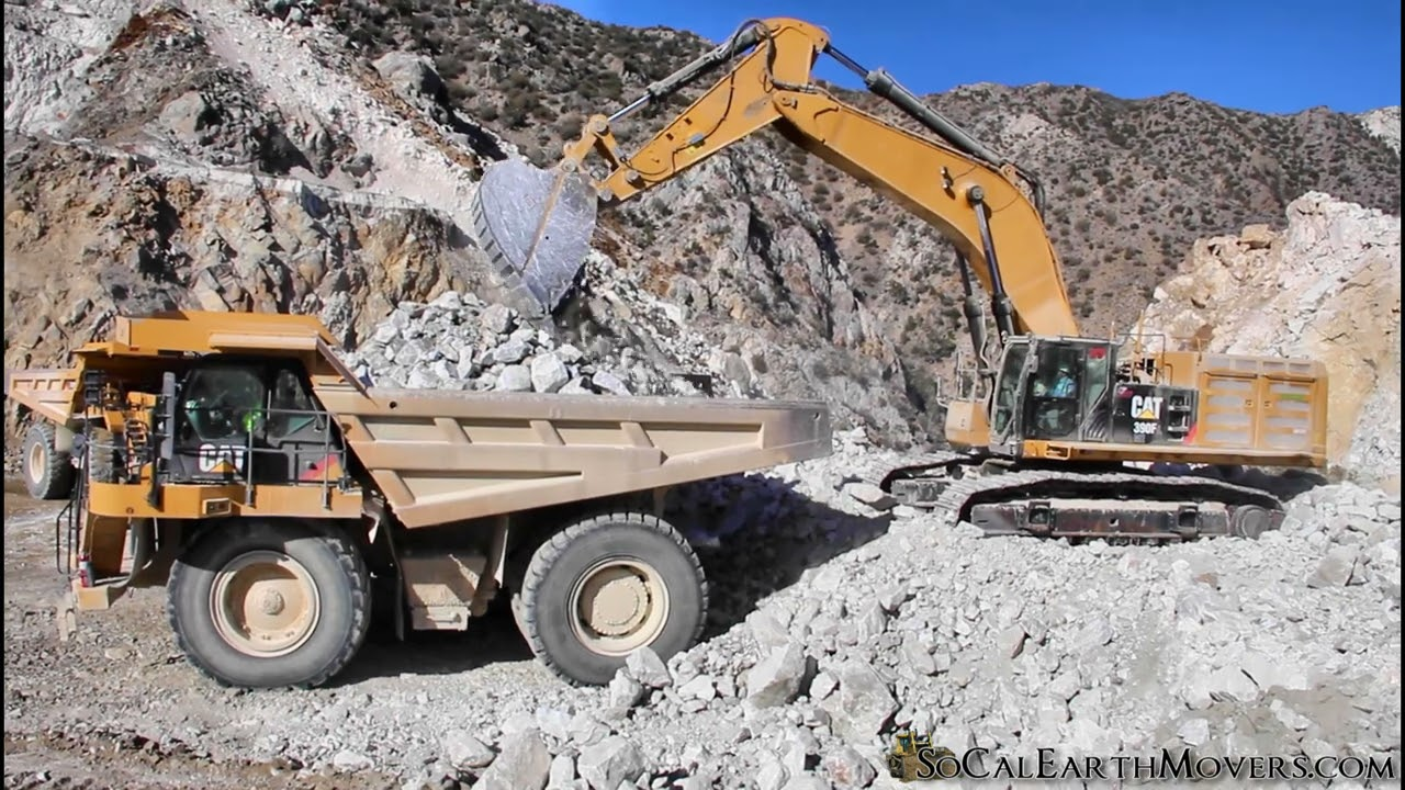 CAT 390F LME loading re-powered tier 4 777F up in the mountains