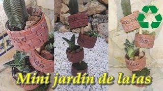 Mini jardín con latas recicladas.