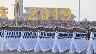 China marks the 70th anniversary of its founding with military parade - watch live