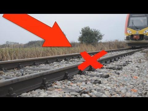 EXPERIMENT TRAIN VS CUCUMBER Loram rail grinder under train view
