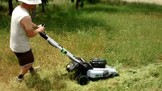 EGO Self Propelled Lawn Mower on a hill with knee high grass