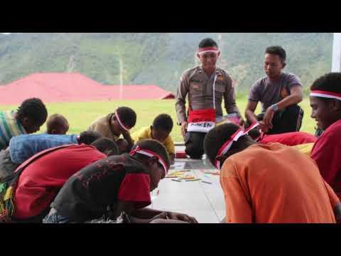 Binmas Noken Polres Puncak Jaya Sentuh Anak-Anak Kampung Jiginikime Dengan Kasih Sayang