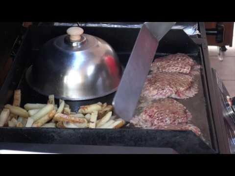Griddle Hamburgers, Hot dogs and fries on a Griddle Plate